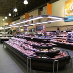 Attractive displays with Promolux over a self-serve meat case