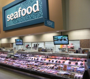 Promolux LEDs merchandising a service and self-serve seafood case