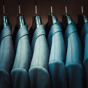 Close-Up-of-Suits-on-Hanger