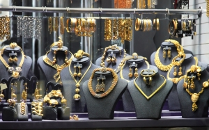 Gold jewelry on display, luxurious gold counter, a beauty and luxury gift for a woman