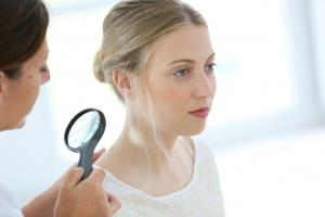 Dermatologist skin examination
